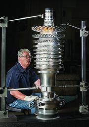 David Griffin, a development mechanic at GE's Evendale plant, inspects a LEAP-X compressor rotor.