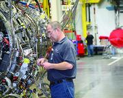 Philip Schellenbach, an instrumentation mechanic at GE Aviation's Evendale plant, installs testing instrumentation on an F136 engine.