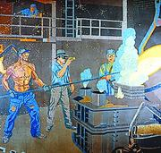 This mural shows a worker pouring molten metal at American Rolling Mill in Middletown.
