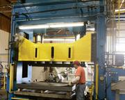 Installed in 1992, Aurora's 2,500-ton press is the largest in the casket industry. Here it's used to stamp casket lids.