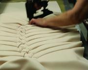 Interiors are mostly sewn by hand in a variety of fabrics, including crepe, velvet, linen and other specialty fabrics.