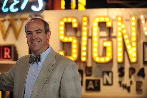 Eric Avner is vice president and senior program manager for the Haile/U.S. Bank Foundation, which is funding CoSign. Behind him is the lead grant recipient, the American Sign Museum.