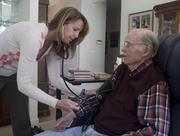 Barb Hankin, RN, is a nursing supervisor and community liaison with Black Stone. She makes periodic visits to client homes to evaluate the care they are receiving from Black Stone staff. She takes Jim Cobb's blood pressure at his Montgomery home.