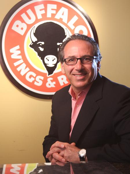 """""""2011 is a privotal year ... as we look to grow our national footprint,"""" says Roger David, president and CEO at Buffalo Wings & Rings."""