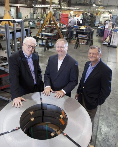 """""""They have a great management team,"""" C.M. Paula CEO Greg Ionna, left, said of Art Technologies. Next to him is Robb McCoy, president of Art Technologies, and C.M. Paula CFO Bill Creager."""