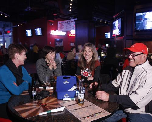 The Holy Grail at the Banks is already planning to expand. From left, Nancy Tyler of Anaheim, Calif., Sharon McCarty, Jill Dietz and Mike Roe of Cincinnati enjoy the atmosphere during a Reds game.