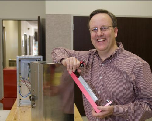 Jacobs Automation founder and CEO Keith Jacobs is shown with some of the company's  Maglev technology, which is designed to replace much of the hardware on packaging/material  handling machinery with software.