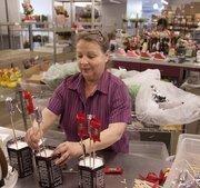 Valerie Rich works on an arrangement at Jones the Florist's Blue Ash design center.