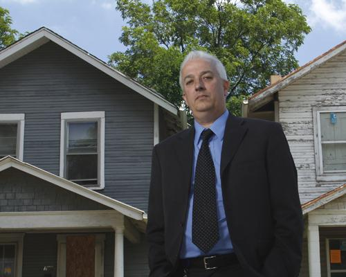 Doug Adkins, Middletown's community revitalization director, stands in front of two of the city's thousands of vacant properties, which he hopes to have removed with funds from the a new county land bank.
