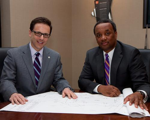 MV Construction president Chris Knueven, left, and Mark Parks of Karrington Co.