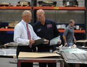 Metalworking Group's Jeff Denny goes over some specifications with President Mike Schmitt.