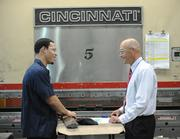 Metalworking Group's Greg Johnson talks with company President Mike Schmitt.