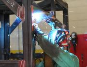 Employee Chad Huff welds a product at Metalworking Group in Colerain Township.