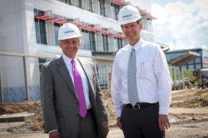 CEO Ken Oswald, left, and Bob Wassler, president, visit a job site in Norwood. Oswald has an 86 percent rate of repeat clients.