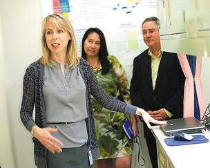 Dr. Svetlana Farrell, left, gives a tour of a clinical testing area at P&G's Mason Business Innovation Center.