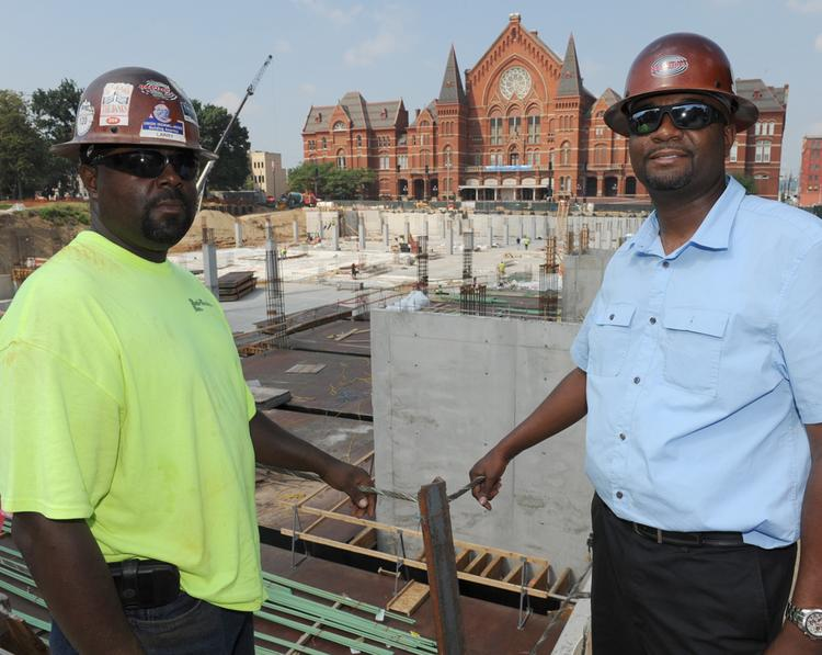 Larry Packer, left, has been supervising Rod-Techs' work on the Washington Park site. His brother Chris, right, president of Rod-Techs, calls the project the best his firm has ever won.