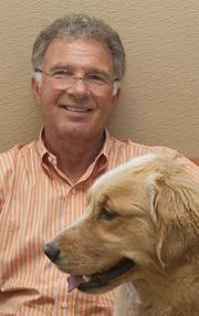 Local entrepreneur Ray Schneider opened Red Dog Pet Resort and Spa in Madisonville five years ago. He recently opened a second location in Boston and would like to expand again.