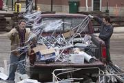 Scrap dealers want the city to cover the costs of their legal fight.