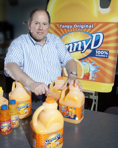 Richard Zimmerman, Sunny Delight's head of marketing, compares the old and new bottles.