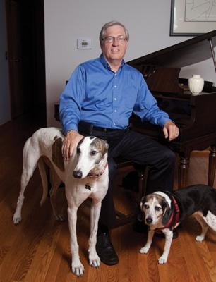 Jim Cunningham, of Queen City Angels and the Circuit, works from his home. Dogs Eric, a greyhound and Annie, a beagle, are  part of his extended family.