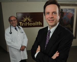 """It's important to have the physicians and hospitals sitting at the same table,"" said Gerald Oliphant, right, TriHealth's chief operating officer. Dr. Georges Feghali, left, is TriHealth's chief medical officer."