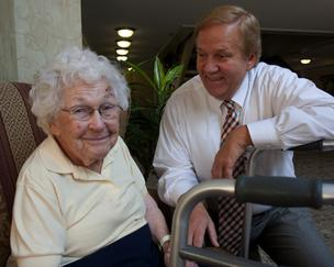Mark Wellinghoff, administrator at Brookwood Retirement Community, talks with resident Kathryn Daum, 97. Brookwood is owned by Cincinnati-based Health Care Management Group.