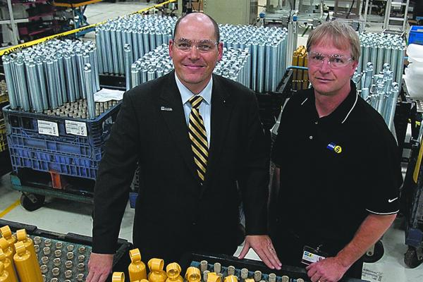 ThyssenKrupp Bilstein of America CEO Fabian Schmahl, left, expects new business to drive sales. At right is Eric Giese, manager of the Hamilton plant.