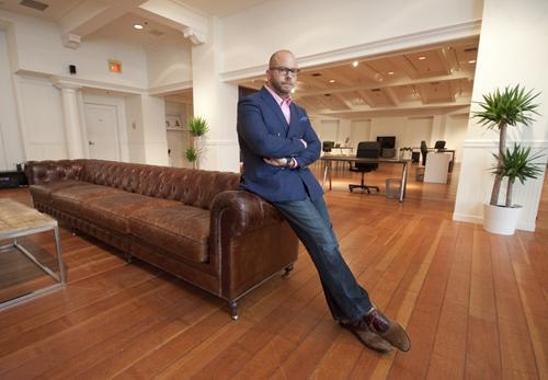 Chris Ostoich, founder and CEO of BlackbookHR, moved into the former Banana Republic space in Tower Place Mall.