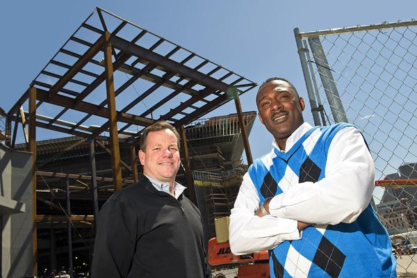 Valley Interiors' Jeff Hudepohl, left, bought a stake in Ishmael Jackson's Alpha & Omega Construction Builders.