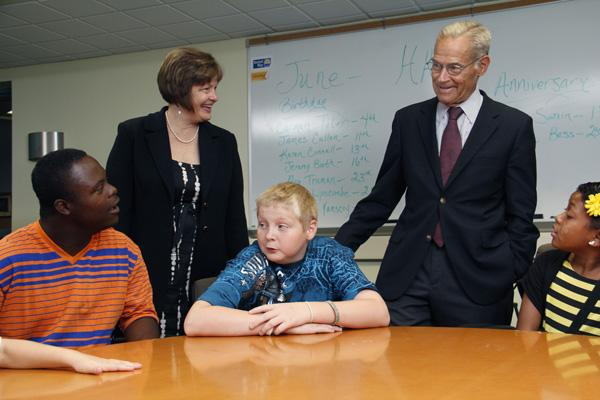 John Pepper and Jane Keller meet kids at the Cincinnati Youth Collaborative, which Pepper helped found. The nonprofit is merging with Jobs for Cincinnati Graduates, with Keller as CEO.