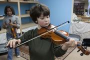 Like all fourth-graders at Cincinnati Waldorf, Owen Gunderman is learning to play a stringed instrument.