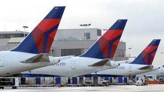Delta and its partners will cut trans-Atlantic flights between 7 percent and 9 percent due to soaring fuel costs and changing demand.