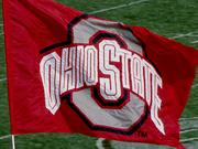 Ohio State University is investigating a new report that players and families of athletes may have had improper dealings with a car dealer who sold them used cars.
