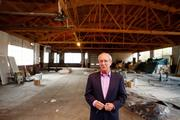 Developer Randy Walker shows the space needs work, but that it's plenty spacious enough to house a grocery store.