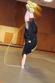 Boggs balances on one hand as she turns.