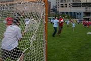 A participant in the downtown event attempts a shot on goal.