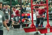 Two men carry large weighted sleds during the Arnold Amateur Strong Man World Championships 2012 on Friday.