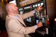 Matt Shindler, Bel Lago's wine director, is overseeing a new wine system that allows purchases by the ounce.