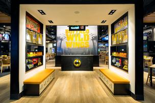 The interior of Buffalo Wild Wings' new prototype highlights the company's retail offerings.