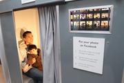 The family gallery photo booth can upload photos to Facebook.