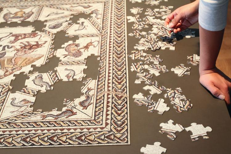 """The special exhibit """"Marvelous Menagerie: An Ancient Roman Mosaic from Lod Israel"""" is better understood by putting together a puzzle."""