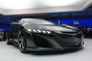 Honda is bringing back the Acura NSX sports car, which features aggressive styling as well as a host of technological features. 