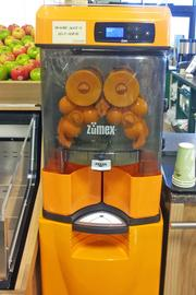 An orange juice machine at an Earth Fare store in Columbus, Ohio.