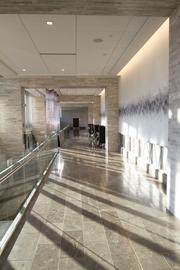 The sunlit east hallway leads to meeting and event space.