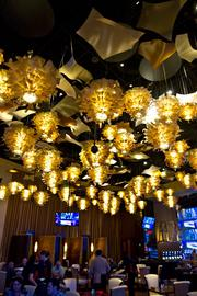 The O.H. lounge will offer refreshments and sports, under a canopy of 'potato-chip' lights.