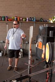 Mike Stepanski led a recent demonstration for visitors, starting with the Hot Shop's two furnaces, which are kept burning 24 hours a day.