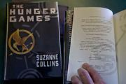 Hoffman says the 'Hunger Games' publisher, Scholastic, uses a numbering sequence ending in 1 to indicate the book is a first edition.