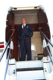 Tom Taylor, NetJets' director of flight standards, welcomed guests on a tour of the plane.