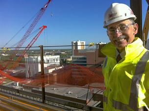Dr. David Schuller stands in what will be a rooftop garden on the 14th floor, where a cafe in the James Cancer Hospital may have outdoor seating.