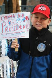A young Obama backer shows his support for the president.
